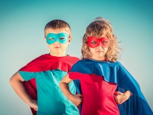 School super heroes represented by children in superhero capes demonstrate getting started with DaySchool.