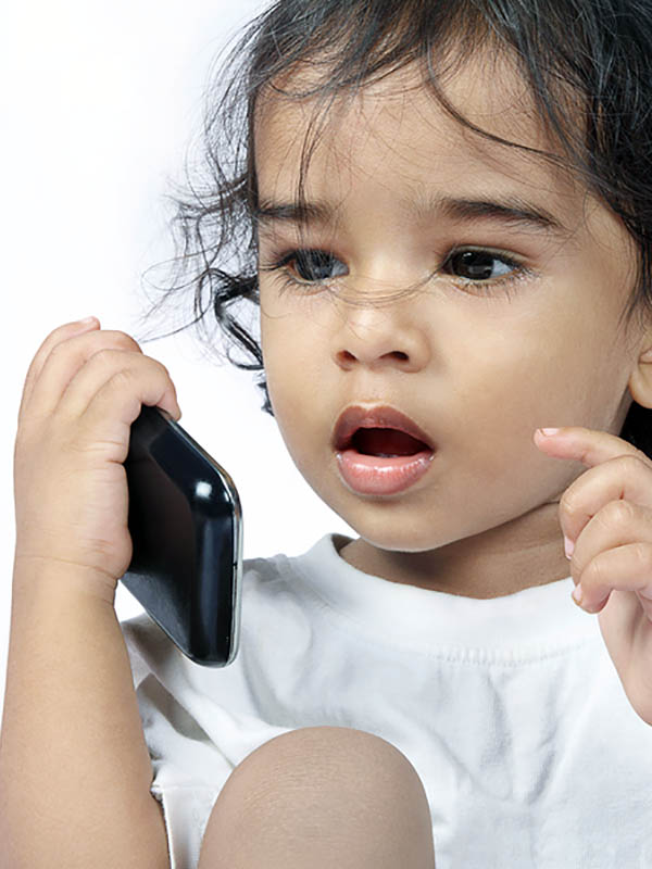 Cute little baby playing with cell phone.