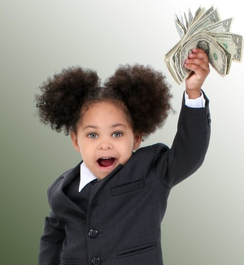 Young girl holding money and shopping for good pricing on software.